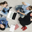 Creative group of students sitting and working together — Stock Photo