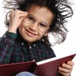 Smart nerd kid with glasses and funny hair writing — Stock Photo #6150244