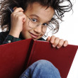 Smart nerd kid with glasses and funny hair writing — Stock Photo #6150246
