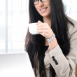 Cheerful business woman holding coffee cup — Stock Photo