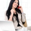 View of beautiful business woman holding cell phone and talking — Stock Photo