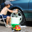 Royalty-Free Stock Photo: Playing around the car and cleaning, children in summertime