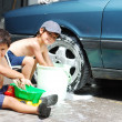 Playing around the car and cleaning, children in summertime — Stock Photo #6150408