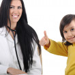 Young female doctor examining little cute happy child with thumb up, good e — Stock Photo #6150440