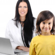 Young female doctor examining little happy cute child — Stock Photo