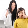Young female doctor examining little cute happy child with thumb up, good e — Stock Photo
