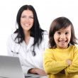 Young female doctor examining little cute child at modern hospital — Stock Photo