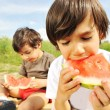 Eating watermelon outside — Stock Photo