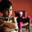 Old style photography: angry boy standing in front of relaxed girl in chair — Stock Photo