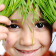Cute happy kid with grass hair — Stock Photo #6150519