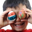 Happy child with Easter eggs — Stockfoto