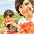 Eating watermelon outside — Stock Photo #6150545