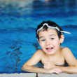 Happy child in a swimming pool — Stock Photo #6150550