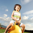 Little happy boy playing with big ball and jumping with slight motion up, s — Stock Photo