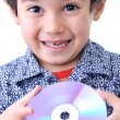 Boy and cd dvd media — Stock Photo #6150570