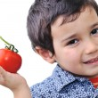 Boy with Tomato — Stock Photo #6150571