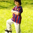 Cute little boy with a ball in beautiful park in nature — Stock Photo