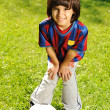 Royalty-Free Stock Photo: Cute little boy playing with a ball in beautiful park in nature