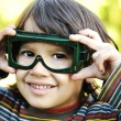 Stock Photo: A little pilot, cute little kid outdoor with glasses on eyes