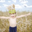 Cute kid in wheat meadow with wheat crown on head — Foto Stock