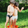 Two kids in basin with water — Stock Photo #6150680