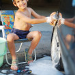 Cute kid washing car — Stock Photo #6150683