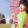 Stock Photo: Cute school girl with umbrella outdoor, fall - autumn time