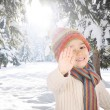Portrait of happy kid wearing warm clothes in snow on a cold winter day, sm — Stock Photo