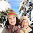Brother and sister on snow, fashionable clothes and happiness — Stock Photo #6150699