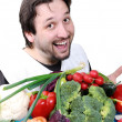 Stock Photo: Man with many different vegetables