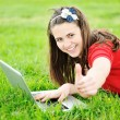 Royalty-Free Stock Photo: Girl with laptop on meadow
