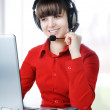 A friendly secretary-telephone operator in an office environment — Stock Photo #6150779