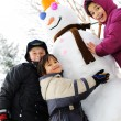 Children and snowman — Stock Photo