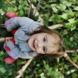 Beauty blond baby on tree leaves ground — Stockfoto