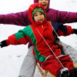 Children have fun together sliding downhill on a pleasant winter day — Stock Photo #6150894