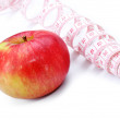 Red apple and Tape Measure close up — Stock Photo