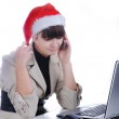 Beautiful business woman is working in office in santa claus hat - talking — Stock Photo #6150938