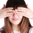 Young teen woman covering her eyes isolated on white background — Stock Photo #6150965