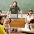 Interaction between teacher and children, funny class in school — Stock Photo #6150986