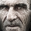 Closeup portrait of old man, wrinkled elderly skin, face — Stock Photo