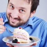 Man eating piece of chocolate cake — Stock Photo