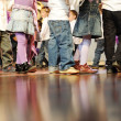 Many little legs - group of children walking together, cute feet - Stock Photo