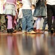Many little legs - group of children walking together, cute feet — Stock Photo