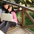 Young couple, male and female sitting in park and studing and workind toget — Stock Photo #6151254