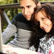 Young couple, male and female sitting in park and studing and workind toget - Foto de Stock