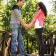 Stock Photo: Beautiful scene of two teen lovers in nature, young couple together