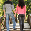 Beautiful scene of two teen lovers in nature, young couple together walking — Stock Photo