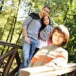 Beautiful scene of young happy family in natural park, three members: mothe — Stock Photo #6151273