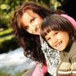 Mom and kid in nature beside the river — Stock Photo