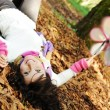 Young beauty girl laying on autumn ground and leaves, perfect face and natu — Stock Photo #6151298